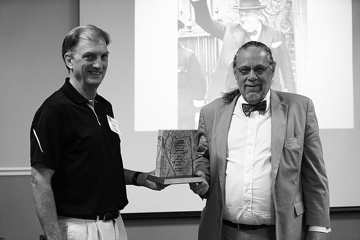 Bob Short receives Special Recognition Award from Ben Mundie of DOGAMI